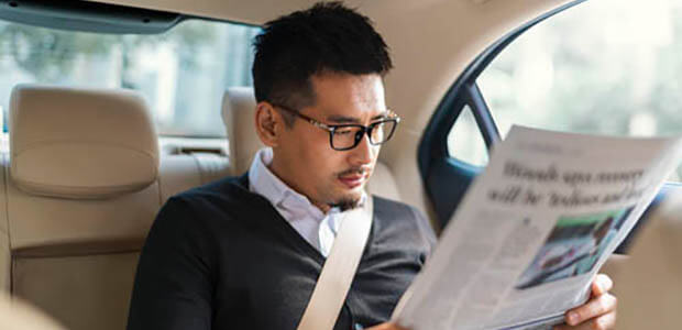 A passenger in an Uber vehicle.